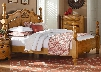 Georgetown Collection 8301123 King Size Poster Bed with Decorative Carved Shell Ornament Curvy Crown Molding and Turned Posts in Honey Pine