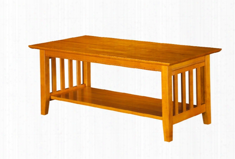 Ah15207 Mission Coffee Table With Apron Molding Detail Tapered Legs And Bottom Shelf In Caramel